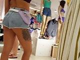 Candid voyeur thick ass in shots with bikini top shopping