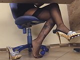 Under the desk of a blonde secretary in stockings