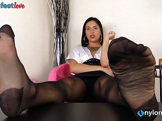 Massage Softcore Foot Fetish video: Hot brunette in pantyhose smokes a cigarette and teases you