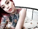 gorgeous tattooed redhead proudly shows pierced tits