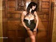 Denise Milani in a black dress - non nude