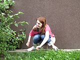 Shy and nervous redhead pees outside