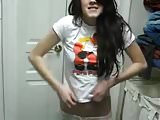 Bedroom camgirl strips off