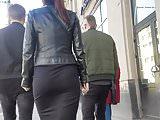 Brunette's ass in black skirt