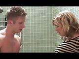 Blonde milf fucks two guys under the shower