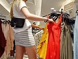 Candid voyeur skinny blonde teen in tight gray skirt mall