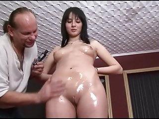 Fingering Teen Handjob video: Teenie girl is oiled & fingered then wanks off 2 older guys