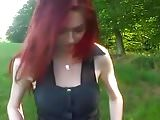 cute redhead flashes and pees outdoors