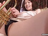 Japanese babe rubs herself with a trumpet and fucks hard
