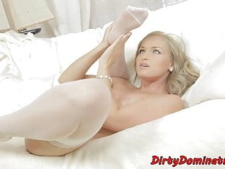 Gorgeous domina satisfying herself with toy