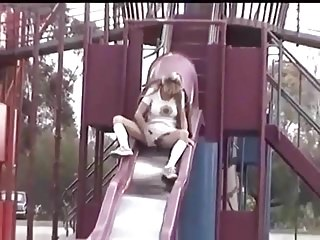 Public Nudity Upskirts xxx: Hot blonde with large pussy lips upskirt peeing over a slide