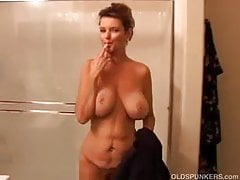 Big tits mature amateur strips off and enjoys a sexy hot