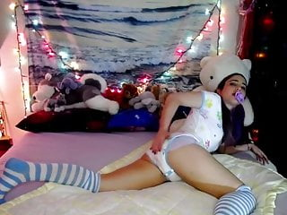 Cute girl farting in a diaper with a dummy