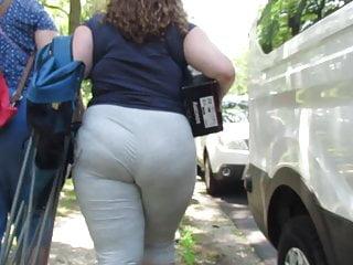 Voyeur Brunette Big Ass video: Brunette BBW panty wedgie in light gray yoga pants