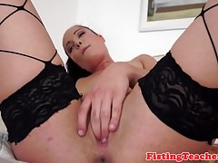 Finger banged lesbo fisting her pussy