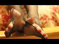 black nylon and red toenails