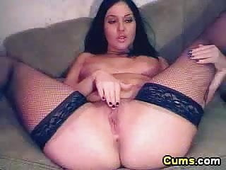 Spreads her legs so wide you can see deep inside her pussy
