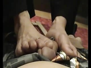 Wife footjob during phone call...