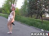 Cute little bunny girl provocative in a outdoor voyeur video