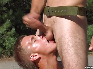 Young gays in uniform exchange blowjobs roadside...