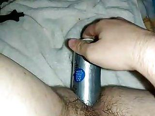 Fucking ass with a large metal dildo...