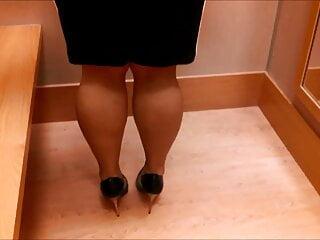 Calves flex under black and white dress