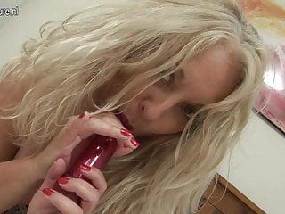 Hot British granny enjoys her dildo