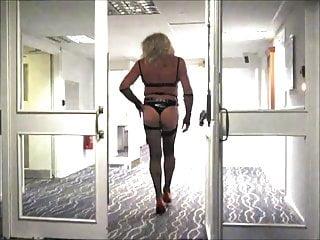 Jane strips to underwear in hotel corridor...