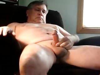 A masturbating in armchair...
