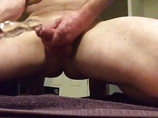 Lubes toy with precum then fucks his ass...