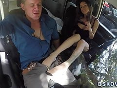 Milf rubs cock with feet in car