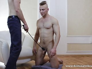 Russian muscular guy is dominated and trained by toys