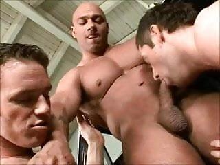 Three muscular car mechanics...