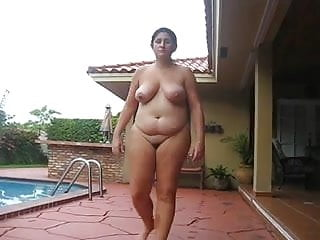 Bbw milf takes naked walk through...