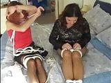 Hogtied slaves tortured on bed