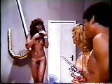 Black guy with a gun fucks women & a trans 1981