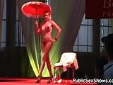 Hot busty stripper posing with umbrella