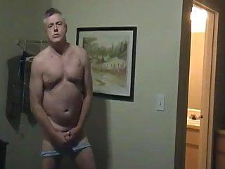Pleasuring himself on bed...