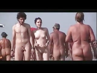 Pale sexy naked couple walk beach...