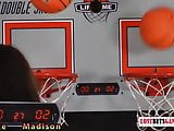 Two adorable girls play a game of strip basketball shootout