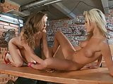 Smoking hot blonde and brunette lick each other in a bar