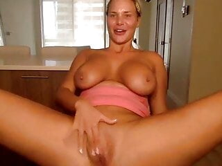 Milf caresses her cunt with a dildo