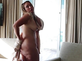 Tanned blonde pawg strips and shakes ass...