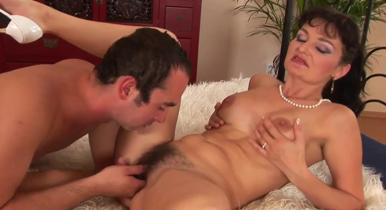 Bushy mom Olive enjoys oral sex