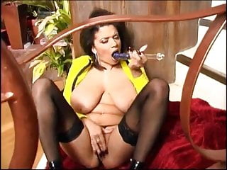British Busty Alexis Silver solo scene in black stockings