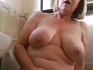 Naked blonde mature moans loudly as she uses...