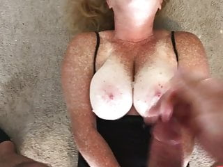 Cumshot on freckled boobs
