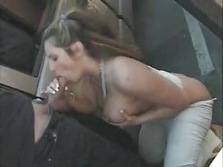 Busty slut sucks a public...