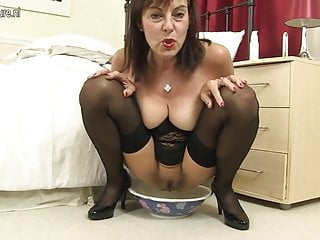 Kinky mother loves pissing bananas and buttplugs...