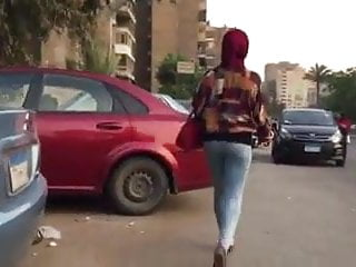 Another hijabi with tight jeans and walking...